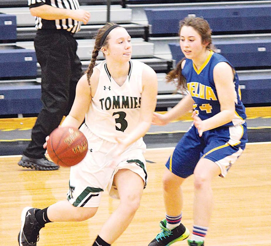 Alex Eisen/MDN Thompson's Allie Ivesdal (3) dribbles the basketball while being guarded by Velva's Hope Brewer (24) Saturday in the Shootout on the Prairie invitational at the Minot Municipal Auditorium.