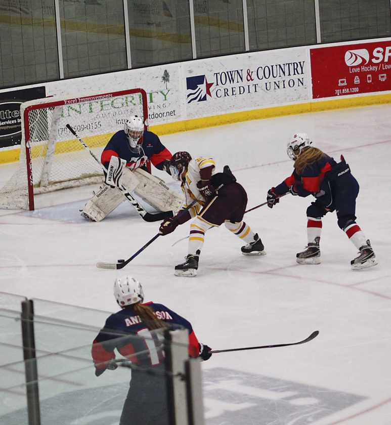 Ashton Gerard/MDN Minot High's Olivia Weisberg goes for the goal in a game Tuesday against the Bismarck Blizzard. The Majettes fell 2-0 to the Blizzard.