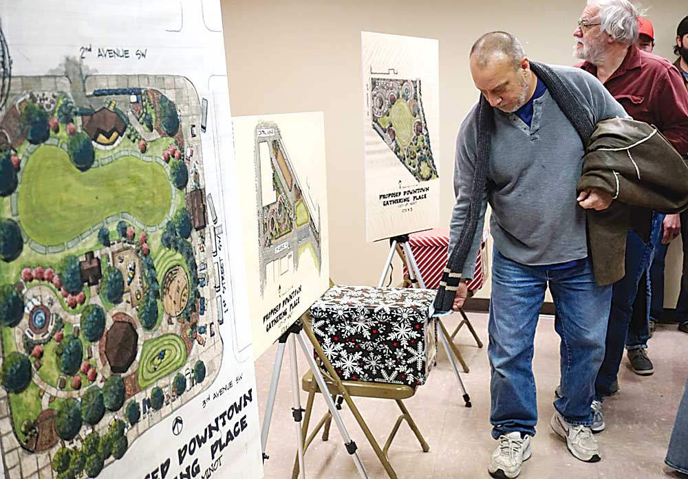 Jill Schramm/MDN Display boards at Tuesday's public meeting show renderings of gathering space concepts and include ballot boxes for residents to cast votes for their top choices.