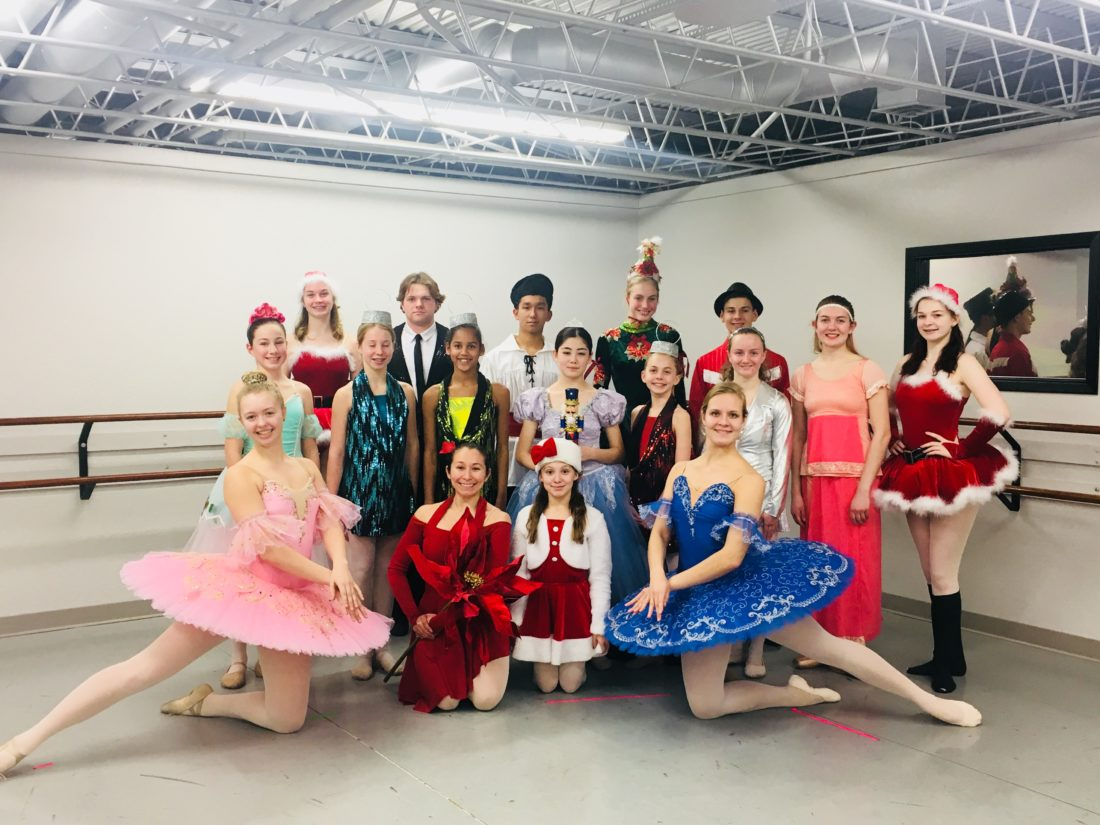 """Mouzafarov's dancers pose in their bright costumes for """"Oh, Christmas Tree.""""  Shyanne Belzer/MDN"""