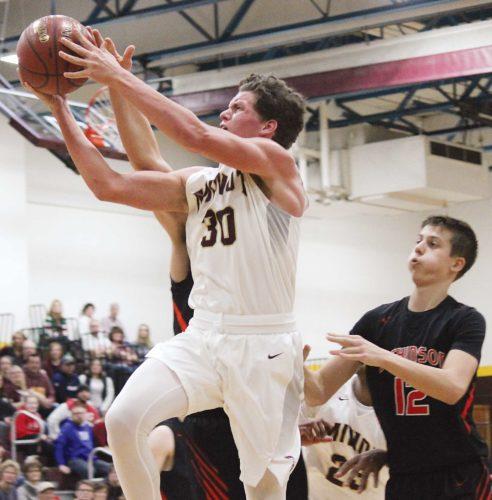 Alex Eisen/MDN Minot High senior Lofton Klabunde (30) drives to the hoop Saturday evening against Dickinson at Minot High School.