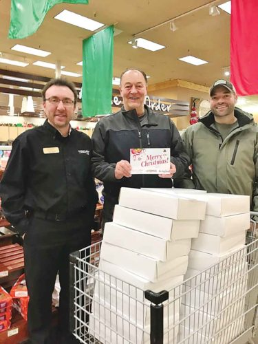 Submitted Photo Thirty-two dozen donuts were distributed to local law enforcement and other first responders Wednesday in appreciation of their dedication to others. Sponsors of the annual give-away are represented here by Craig Heupel, Marketplace Foods; Steve Burton, The Outfitters; and Tyler Burton, Sportsman's Loft.