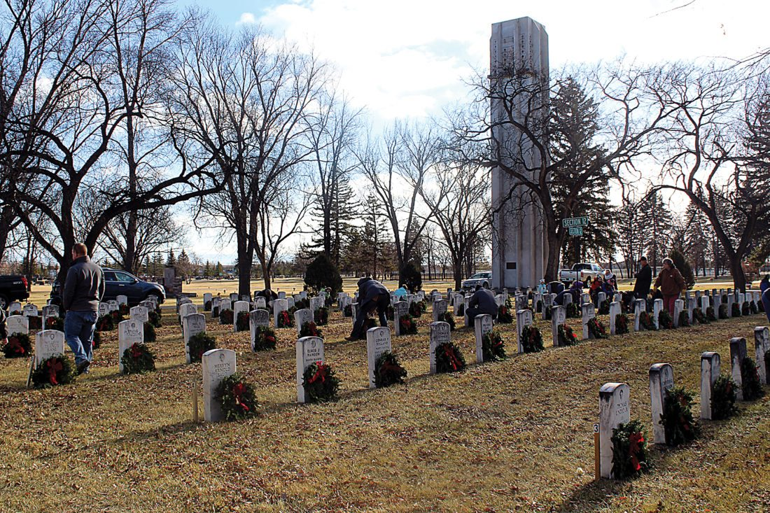 Ashton Gerard/MDN Wreaths were placed at the graves of local veterans Saturday during the Wreath Laying Ceremony for Wreaths Across America in Minot.