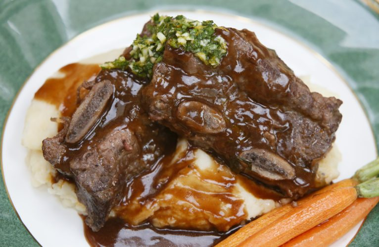 Braised short ribs are presented with mashed potatoes and carrots.  Michael Vosburg / Forum Photo Editor