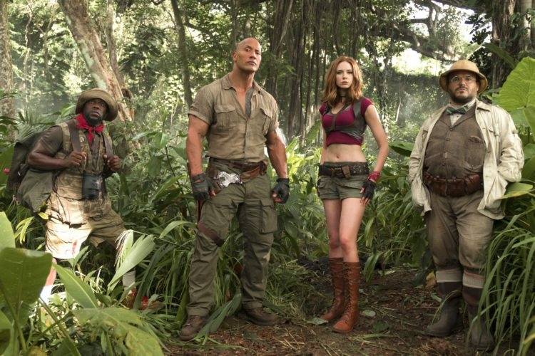 "This image released by Sony Pictures shows Kevin Hart, from left, Dwayne Johnson, Karen Gillan and Jack Black in ""Jumanji: Welcome to the Jungle."" (Frank Masi/Sony Pictures via AP)"