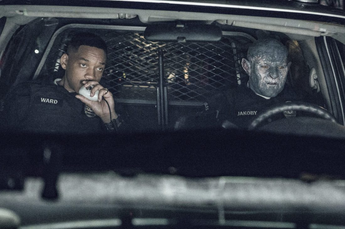 """This image released by Netflix shows Will Smith, left, and Joel Edgerton in a scene from, """"Bright."""" (Matt Kennedy/Netflix via AP)"""