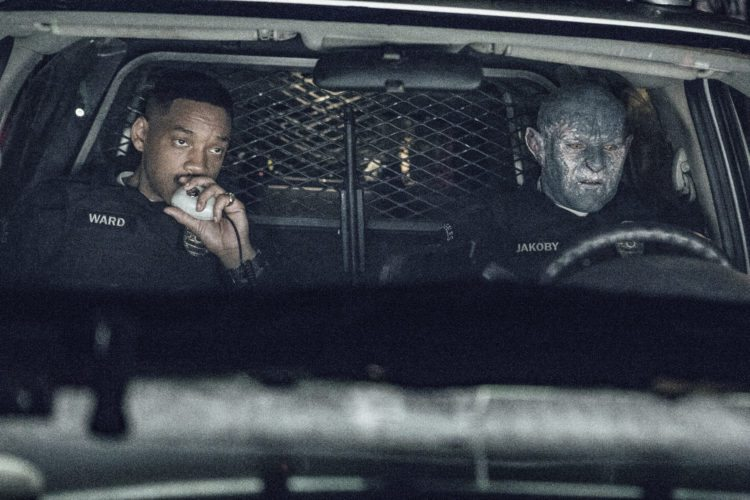 "This image released by Netflix shows Will Smith, left, and Joel Edgerton in a scene from, ""Bright."" (Matt Kennedy/Netflix via AP)"