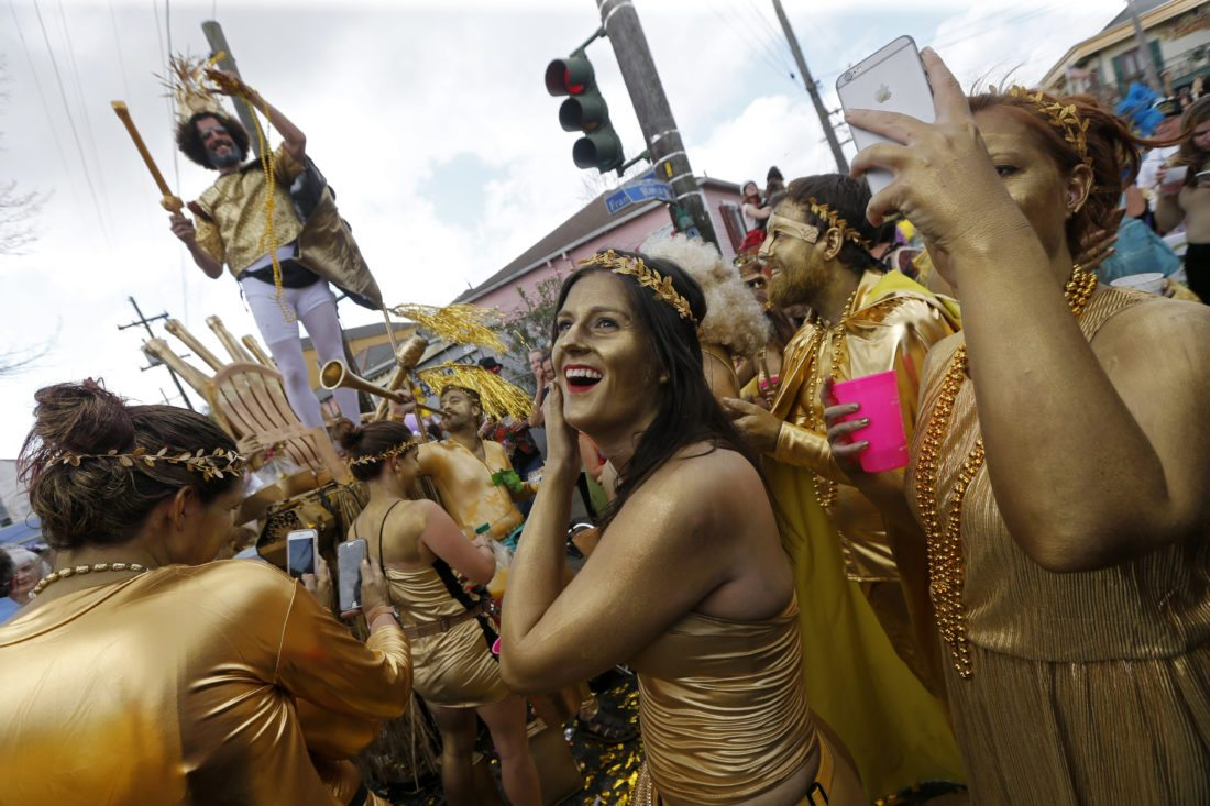 Revelers congregate at the start of the Society of Saint Anne Mardi Gras parade in New Orleans. The city celebrates its tricentennial in 2018. (AP Photo/Gerald Herbert, File)