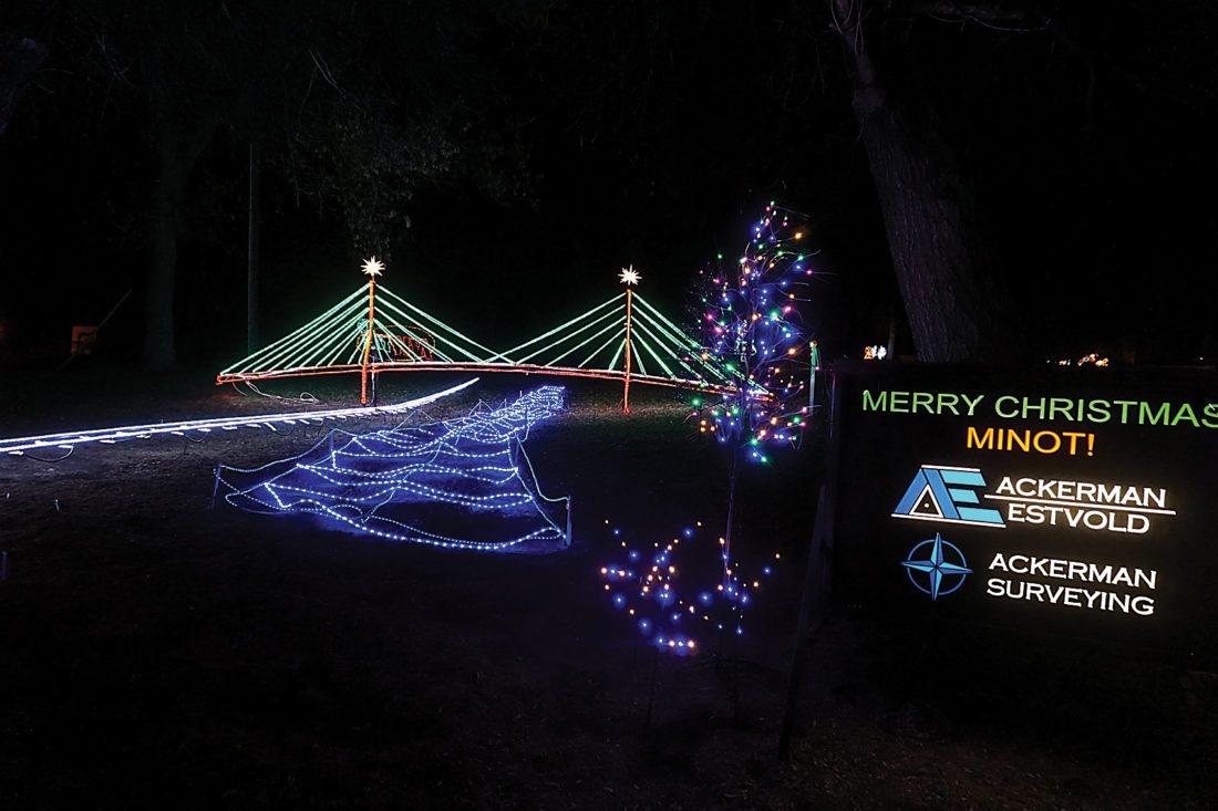 Jill Schramm/MDN A blue-lit river flowing under a bridge is part of the light display sponsored by Ackerman-Estvold