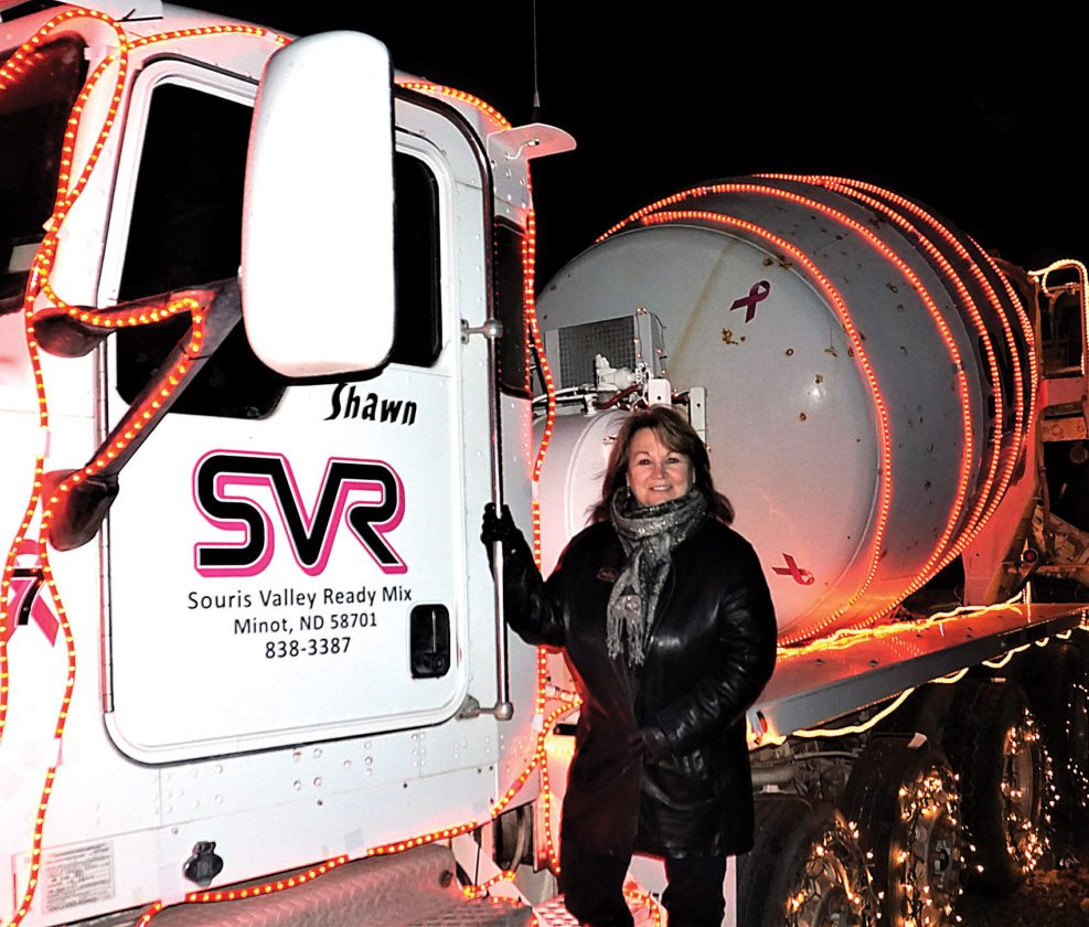 Jill Schramm/MDN Sue Stewart, general manager for Souris Valley Ready Mix, supports Christmas in the Park with her company's lighted truck.
