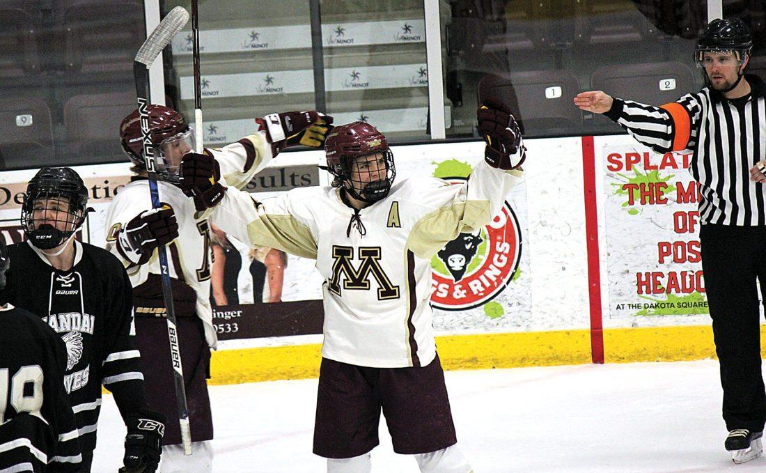 Alex Eisen/MDN Minot High senior Jake Viall raises his arms after scoring a goal against Mandan on Nov. 28 at Maysa Arena.