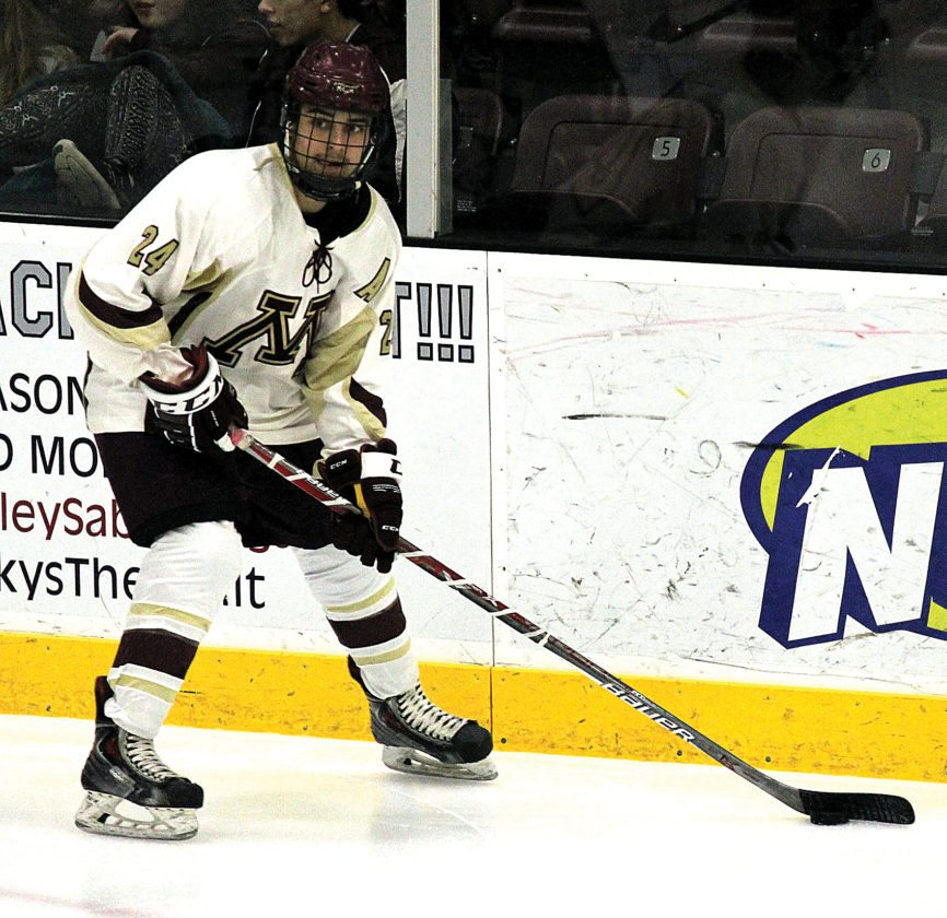 Alex Eisen/MDN Magi junior forward Mason Diehl looks to make a pass in a game played earlier this season in Minot.