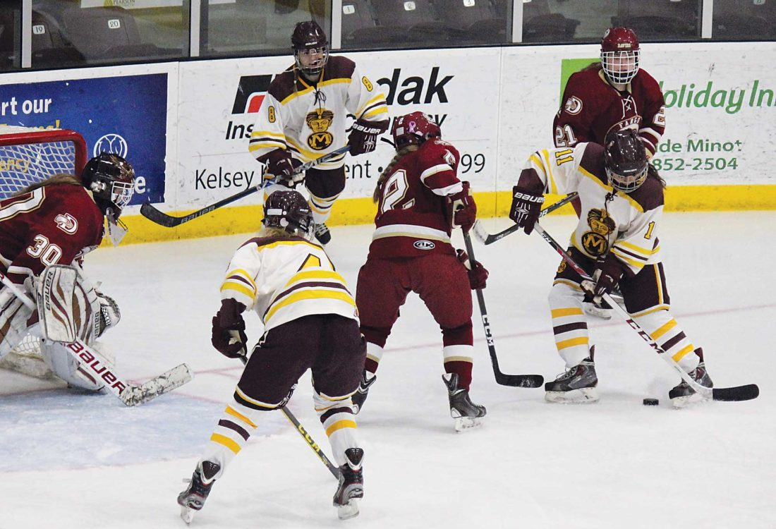 Alex Eisen/MDN Majettes sophomore O'Malley Eslinger (11) gets the puck caught between her skates in a game against Fargo Davies on Dec. 9 at Maysa Arena.