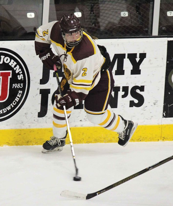 Alex Eisen/MDN Minot High sophomore Dessa Flom (2) skates up the boards in a game played earlier this season at Maysa Arena.