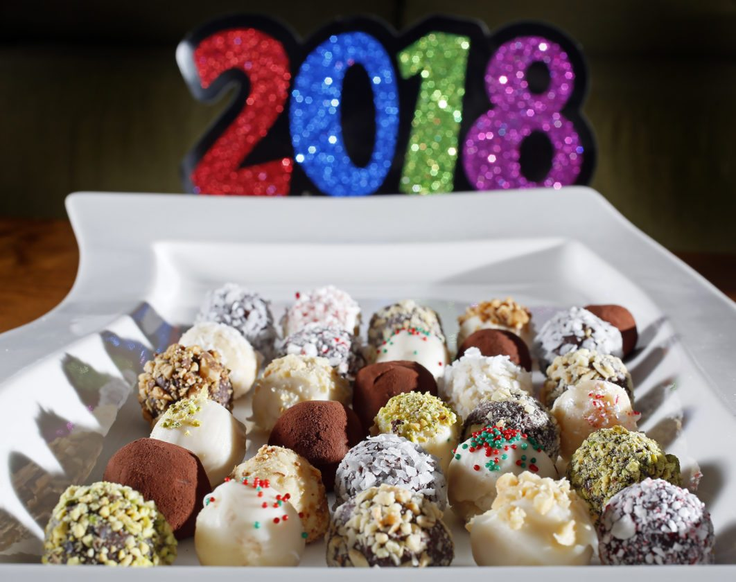 New Year's Eve truffles are made with milk chocolate, white chocolate and dark chocolate.  David Samson / The Forum