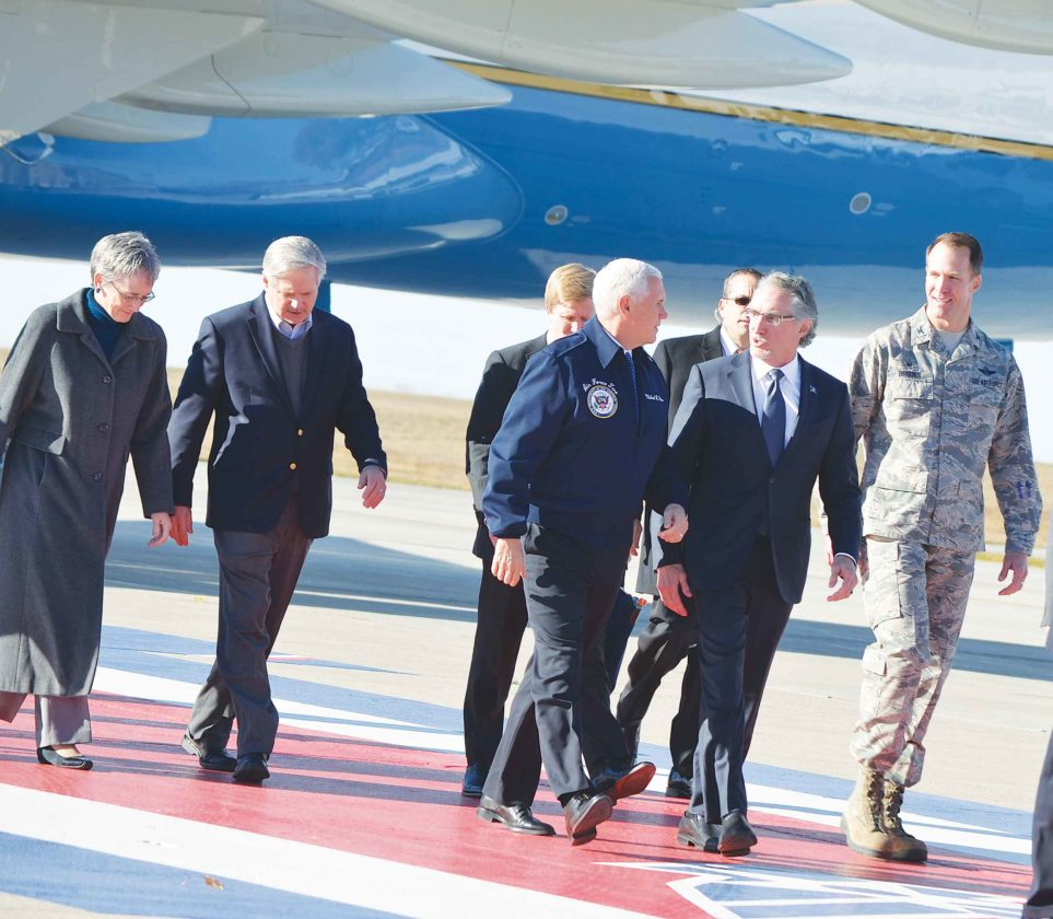 Eloise Ogden/MDN Front, from the left, Vice President Mike Pence, with Gov. Doug Burgum and Col. Matthew Brooks, commander of the 5th Bomb Wing, is shown after leaving Air Force Two on Oct. 27, at Minot Air Force Base. In back, from the far left, are Heather Wilson, secretary of the Air Force, and Sen. John Hoeven.