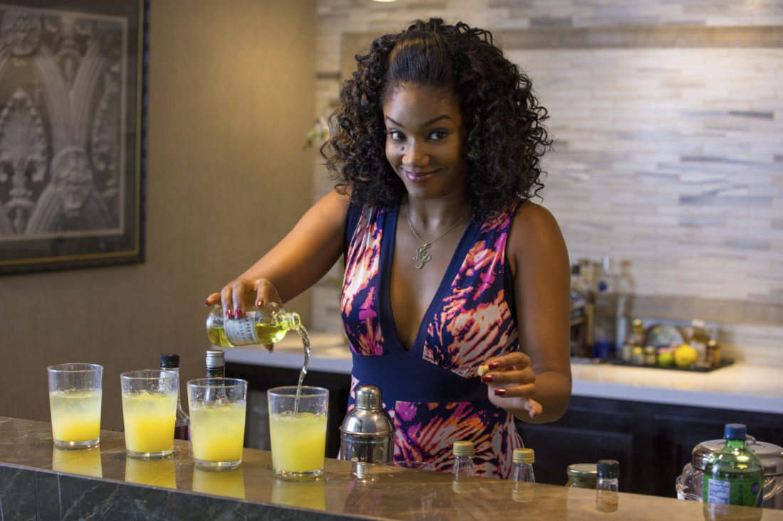 "This image released by Universal Pictures shows Tiffany Haddish in a scene from ""Girls Trip."" Haddish stole the whole of ""Girls Trip"" right out from under her more famous counterparts as the bawdy, take-no-prisoners Dina. (Michele K. Short/Universal Pictures via AP)"
