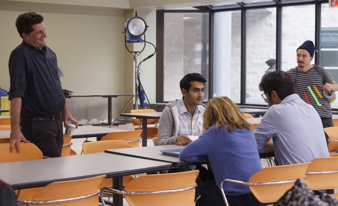 "This image released by Lionsgate shows director Michael Showalter on the set with actors Kumail Nanjiani, seated from left, Holly Hunter and Ray Romano during the filming of the 9/11 scene for ""The Big Sick.""  (Nicole Rivelli/Lionsgate via AP)"