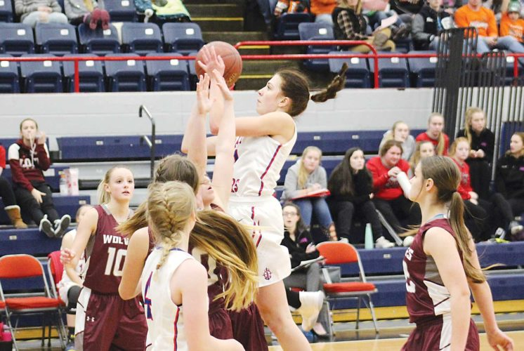 Ashton Gerard/MDN Des Lacs-Burlington junior Kyley Lauf goes up with the ball Thursday in a game against Watford City. Lauf led the team in scoring with a total of 25 points in the Lakers' 56-43 win over the Wolves.