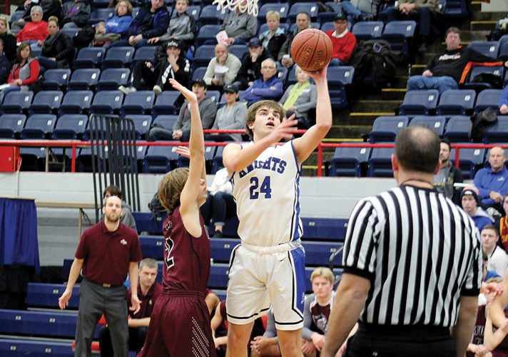Ashton Gerard/MDN Our Redeemer's Leyton Lang takes a shot Friday in a game against Watford City at the Minot Municipal Auditorium.