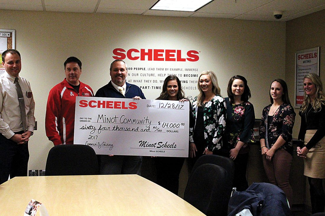 """Shyanne Belzer/MDN Scheel's in Dakota Square Mall gave away a check Thursday afternoon to 13 local organizations. The check totalled $64,000 and is going to be split amongst organizations such as Red Cross, United Way, YWCA, The Boys and Girls Ranch, and many more. The Events Coordinator, Beth Feldner, said """"We are really thankful to say thank you to all the organizations that help our community and to be able to give back."""" The Minot Scheel's opened in 1980 and started doing their Community Giving Event some time after."""