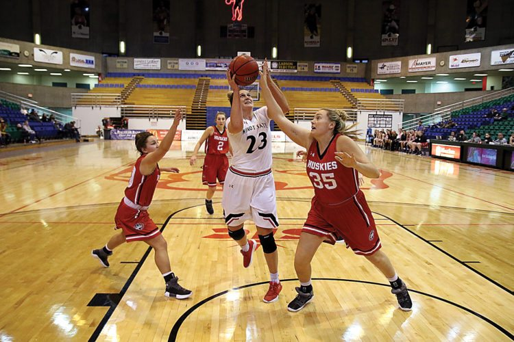 Sean Arbaut/Minot State athletics  Minot State's Holly Johnson (23) shoots a floater during a women's college basketball game Saturday at the MSU Dome.