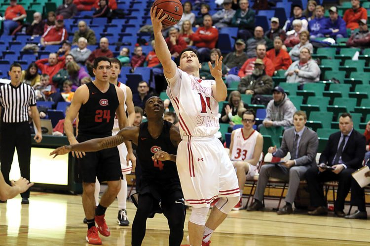 Sean Arbaut/Minot State athletics  Minot State's Luis Ricci Maia (11) puts up a layup during a men's college basketball game Saturday at the MSU Dome.