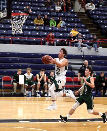 Al Christianson/Photo special to the MDN St. John senior Kyler McGillis (35) converts on a fast break layup against Hazen in a boys basketball game held Saturday at the Minot Municipal Auditorium. St. John won 80-67.