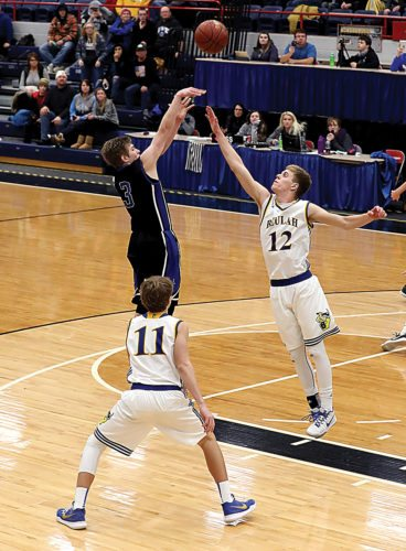 Al Christianson/Photo special to the MDN Our Redeemer's senior Noah Abel (3) makes the game-winning shot over Beulah's Derek Ferebee (12) in a Class B boys basketball game played Saturday evening at the Minot Municipal Auditorium. The Knights won 61-60.