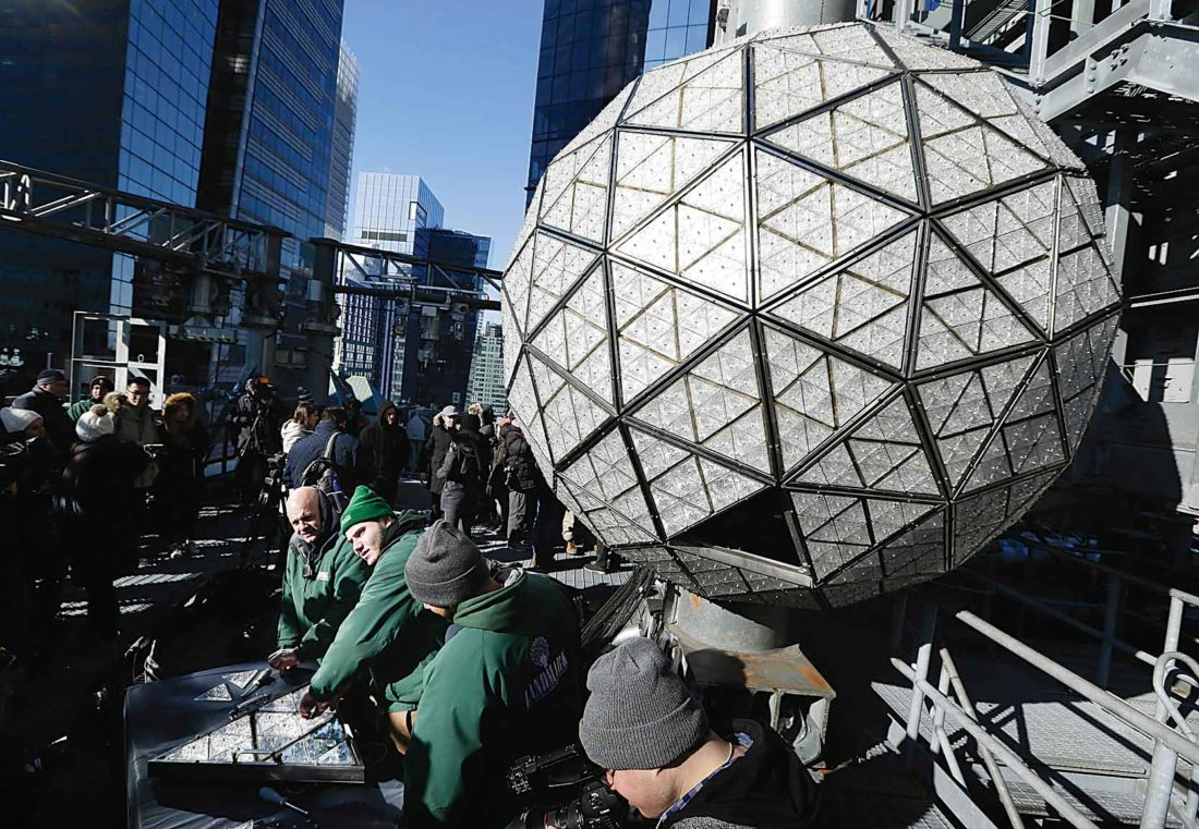 AP Photo Workers prepare to install the last panels on the New Year's Eve ball above Times Square in New York City on Wednesday. The ball, 12-feet in diameter, holds over 2,600 Waterford crystals and is lit by more than 32,000 LED lights.