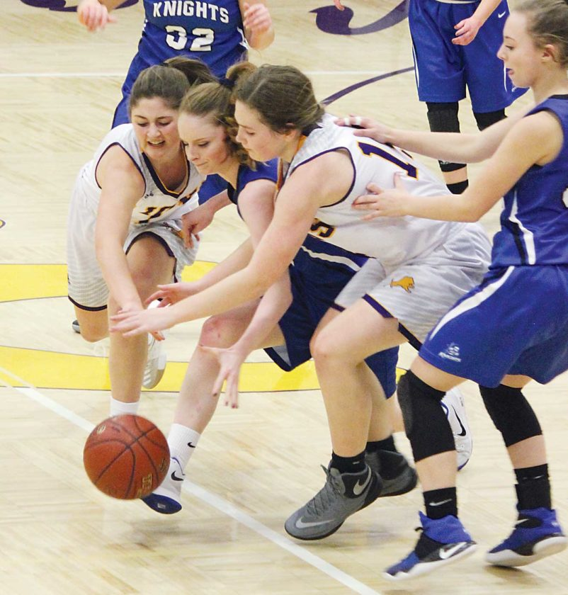 Alex Eisen/MDN Bishop Ryan's Eden Kramer (left) and Grace Candrian (right) fight for a loose ball with Our Redeemer's Karolynn Winger (middle) in a District 12 girls basketball game played Tuesday at Bishop Ryan.