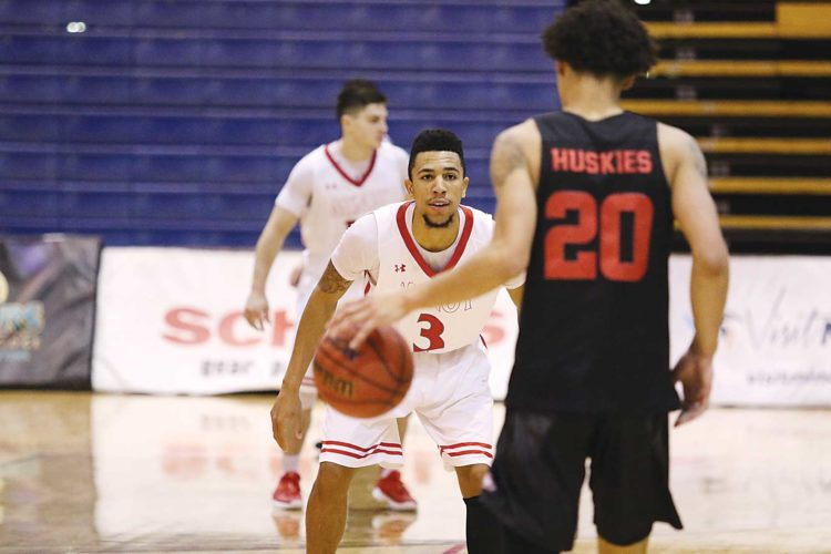 Sean Arbaut/Minot State athletics Minot State's Brandon Green (3) guards St. Cloud State guard Gage Davis (20) during a men's college basketball game Saturday at the MSU Dome in Minot.