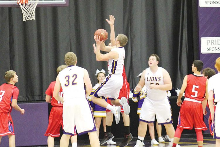 Ashton Gerard/MDN Ben Bohl of Bishop Ryan goes up with the ball Thursday at home against TGU. The Lions defeated the Titans 91-33. Bohl scored 19 points for the team, second behind Mason Hedberg with 27.