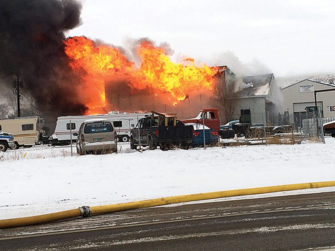 Michael Sasser/MDN A Friday morning fire claimed a shop and warehouse at Roughneck Auto on Minot's east side. There were no injuries reported.