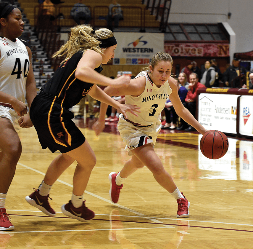Garrick Hodge/MDN  Minot State's Maddie Wald (3) drives to the lane during a women's college basketball game Saturday in Aberdeen.