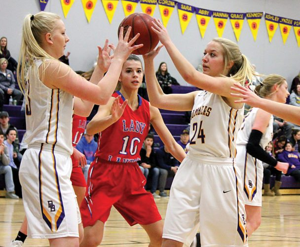 Alex Eisen/MDN Lewis & Clark-Berthold sophomore Hannah Ibach (24) passes the ball to junior teammate Abby Simons in a District 12 girls basketball game played Monday in Berthold.