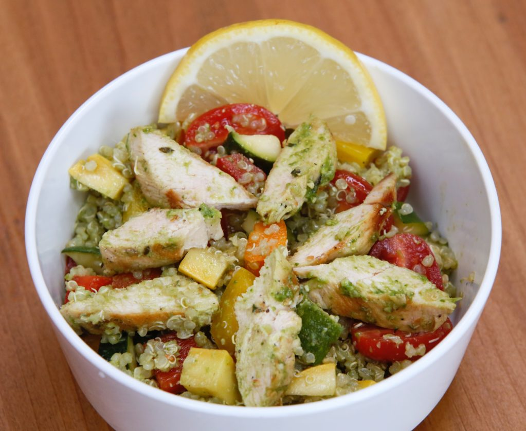 Pesto quinoa lemon chicken salad is mixed.   Michael Vosburg / Forum Photo Editor