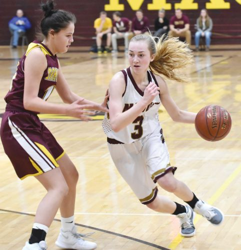 Garrick Hodge/MDN Minot High guard Paige Rosencrans (3) drives to the basket during a girls high school basketball game Tuesday in Minot.
