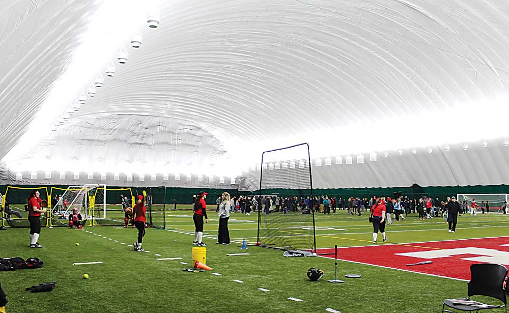 """Ashton Gerard/MDN The 86,000 square feet inflated dome is open and available for area sports and recreation teams to use. Residents of Minot braved the snow to see inside the """"bubble"""" Wednesday during an open house at Minot State University."""