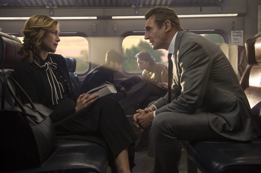"This image released by Lionsgate shows Vera Farmiga, left, and Liam Neeson in a scene from ""The Commuter."" (Jay Maidment/Lionsgate via AP)"