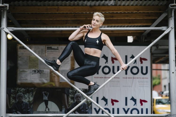 This Oct. 26, 2017 photo shows Bethany C. Meyers in New York City, where she uses the urban landscape for workouts. There are tons of amazing streaming workout options out there and Meyers has a new streaming workout called be.come, which is a music driven mash-up of low impact yoga, pilates and strength training. (Victoria Matthews/Bethany C. Meyers via AP)