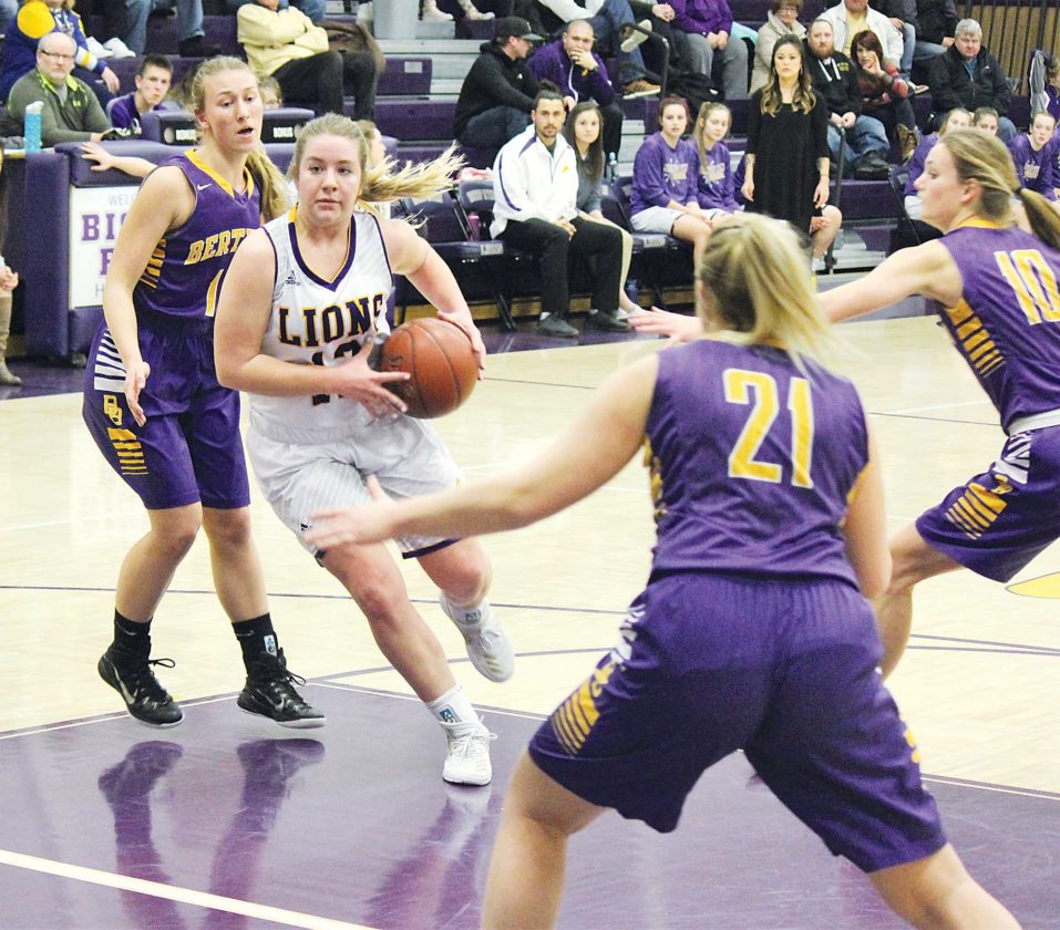 Alex Eisen/MDN Bishop Ryan junior Sealy Rovig drives into the middle of the lane in a District 12 girls basketball game against Lewis & Clark-Berthold Thursday evening at Bishop Ryan Catholic School in Minot. The Lions won 41-38.