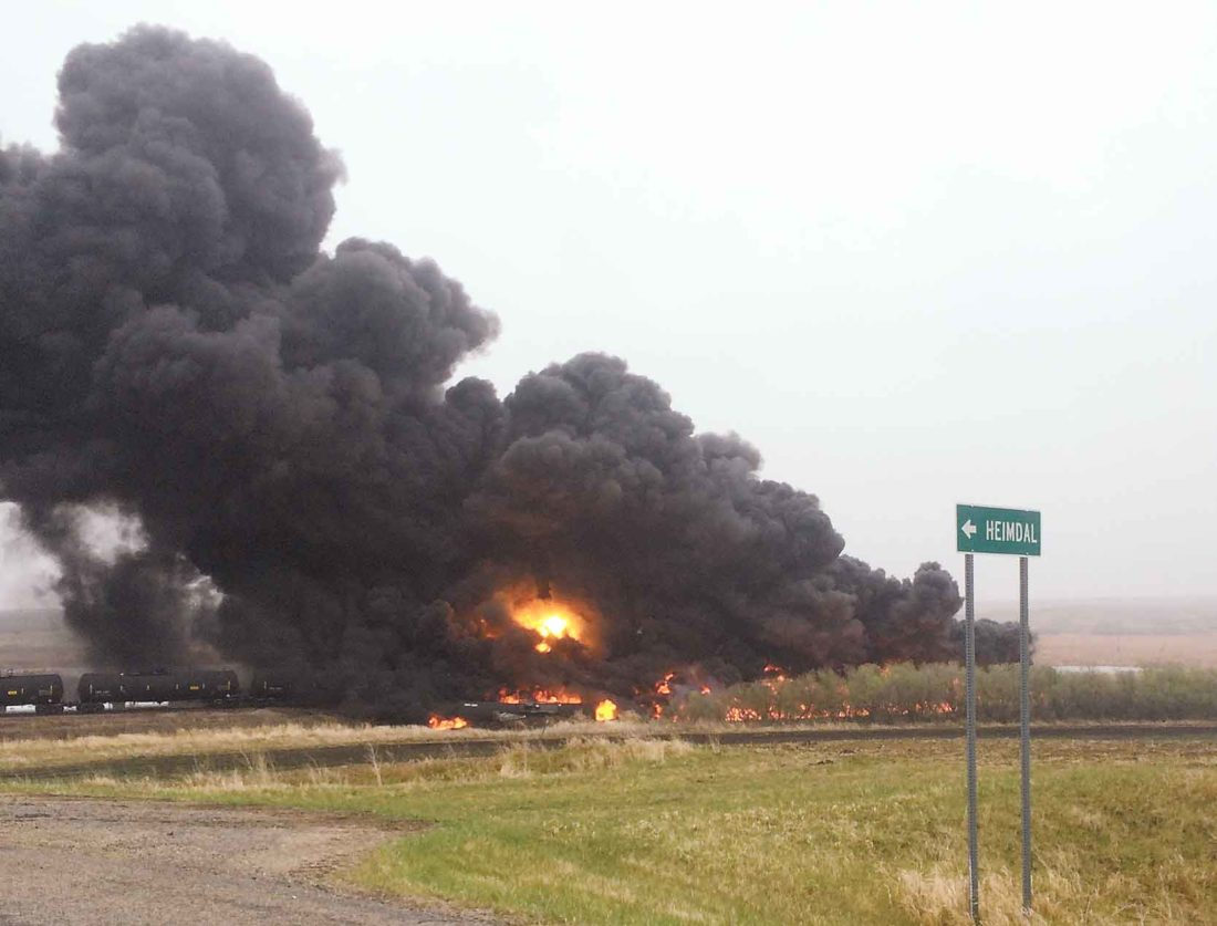 File Photo Smoke plumes rise from a derailment near Heimdal on May 6, 2015.