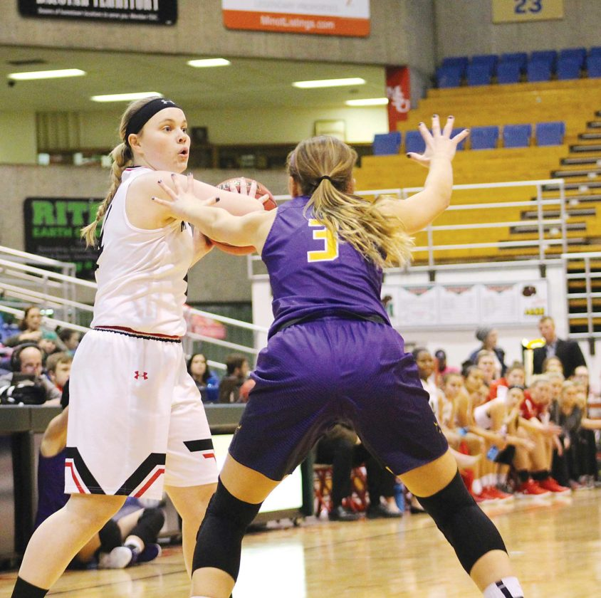 Garrick Hodge/MDN  Minot State's Mariah Payne surveys the passing lanes during a women's college basketball game Friday at the MSU Dome in Minot.
