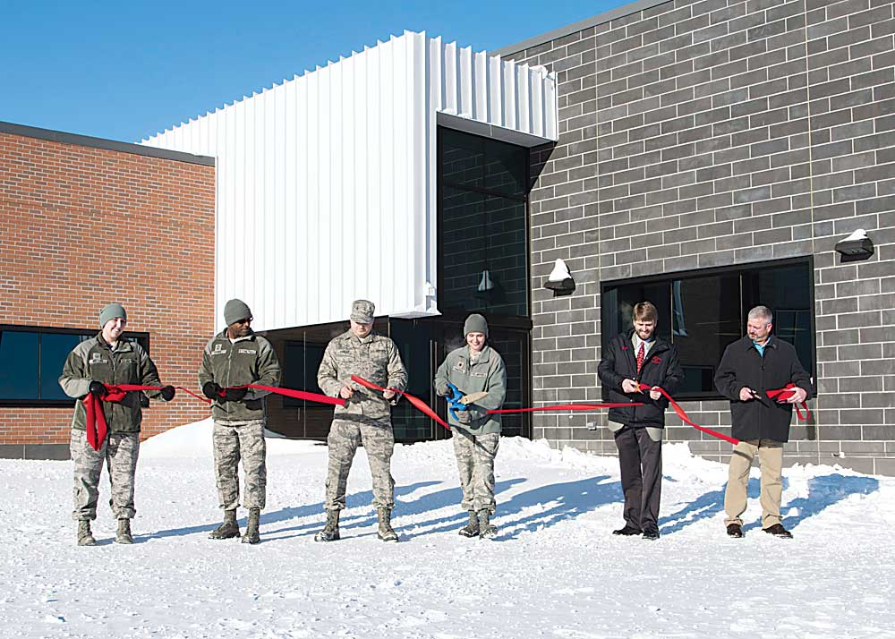 Submitted Photo Maj. Kristen Shadden, 5th Aircraft Maintenance Squadron commander, and squadron airmen are joined by community partners in a ribbon-cutting ceremony at Minot Air Force Base on Friday, shown in this photo by Airman 1st Class Ashley Boster. Construction on the B-52 aircraft maintenance building began in April 2016 to accommodate the additional manpower who maintain the B-52H Stratofortress.