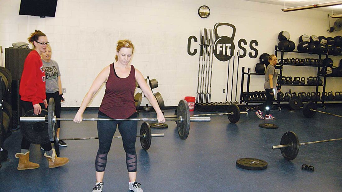 Andrea Johnson/MDN People work out at the Minot Family YMCA earlier this month. Certified personal trainers Tanya Gillen and Nicole Myers say many people start new fitness programs in January.