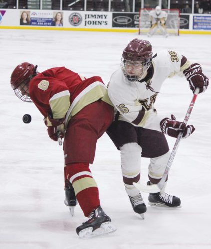 Alex Eisen/MDN Minot High senior Blake Nelson (36) loses a faceoff to Fargo Davies senior Griffin Hart (8) in a boys hockey game played Saturday afternoon at Maysa Arena.