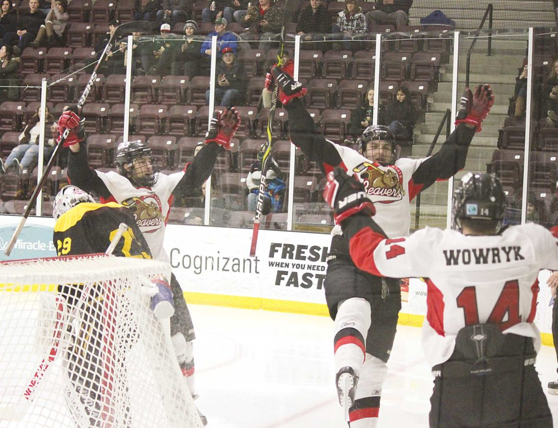 Alex Eisen/MDN Dylan Johnson (center) celebrates after scoring the Beavers fifth goal Saturday evening against Arizona State at Maysa Arena.