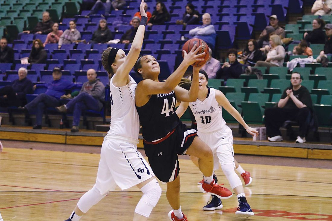 Minot State's Diondra Denton (44) puts up a shot during a women's college basketball game Saturday at the MSU Dome.   Sean Arbaut/ Minot State atheltics
