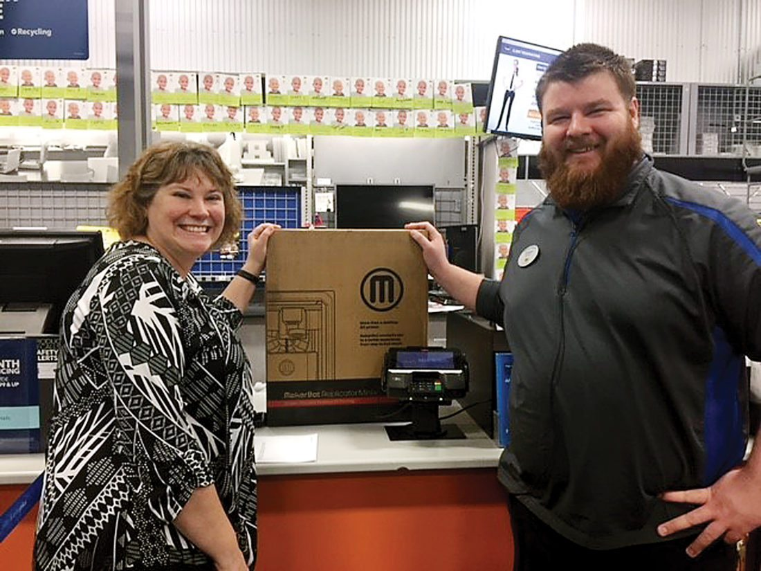 Submitted Photo Pam Carswell, Teen Librarian at the Minot Public Library, and Grayson Leder, supervisor at Minot's Best Buy store, show off the new 3D printer that will be available this year at the library thanks to the Best Buy Community Grant.